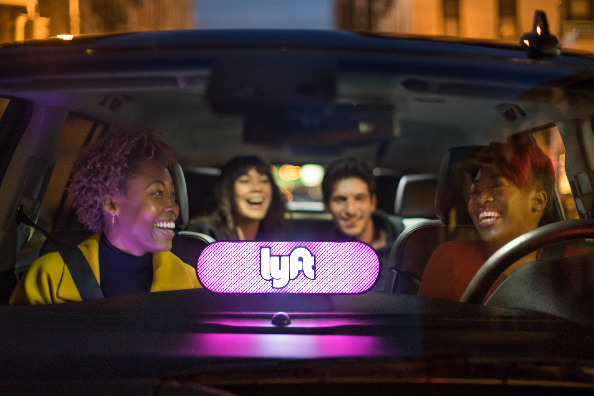 People in a Lyft ride.